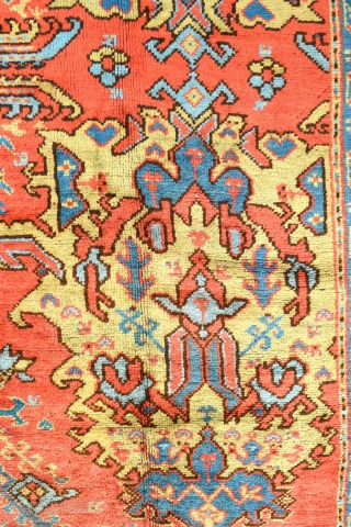 An antique Turkish Ushak carpet. Glowing natural dyes including a particularly attractive ground colour. All over Smyrna design of grand scale. A very decorative piece in excellent condition, full pile with original  ...