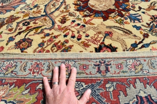 An Old Persian Tabriz carpet of Benlyan type. A highly decorative item with all-over palmetes and hunting animals woven in muted dyes on soft ivory ground. The piece is in excellent, original  ...