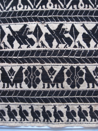 "Mystery textile.  Seems to be embroidered with wool on cotton, in a couched stitch.  17"" x 21.5"".  Viewed from the revers, the birds are white."