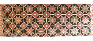 "Graphic Swedish textile, stars on black, wool on linen, approx. 21"" x 61"""