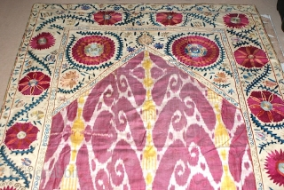 19th cent Uzbek Bucharan region Suzani. Excellent veg dyes colours and superb chain stitches. It has nice adras ikat middle of the suzani. Good condition. It is quite large size.