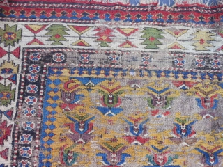 Caucasian Soumac fragment, late 19th century, 2-5 x 3-8 (.74 x 1.12), great greens and yellow, cut and rejoined, worn, holes, rug was washed, plus shipping.