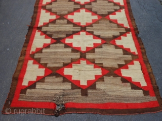 Navajo Transitional, early 20th century, 4-2 x 6-0 (1.27 x 1.83), no dye run, no stains, hole and weak area one end, 2 small holes on edge, could use a cleaning, plus  ...