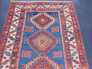 Caucasian Kazak, late 19th century, 4-4 x 8-8 (1.32 x 2.64), good condition, rug was washed, browns oxidized, original ends and edges, one end has original braiding, good pile, few moth bites,  ...