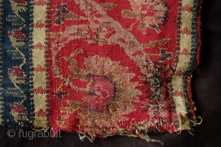 Kashmir Long Shawl Fragment, Early 19th Century. Woven in one long piece. Wide bands of elegant scrolling floral vines. It has a couple of areas of darning.  A wonderful example and  ...