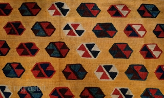 Qashqa'i Kilim, Late 19th Century. Repeating small medallions on a rich yellow ground. White diagonal stripes break up the uniformity. It is also unusual in the way that the medallions in the  ...