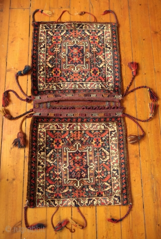 Khamseh Khorjin, late 19th century. A fantastic bag with almost all tassels in tact. Colorful and rich extra wrapping along the center. The wool is lustrous. In about as perfect condition as  ...