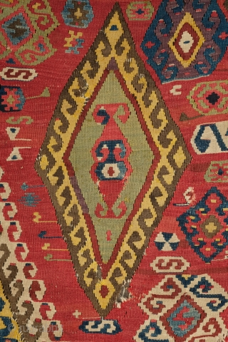 Central Anatolian Kilim, mid-19th century.  A blitz of colors.  Strongly archaic designs.  Very ethnographic and filled with portent. Rare type. 183 x 310 cm.