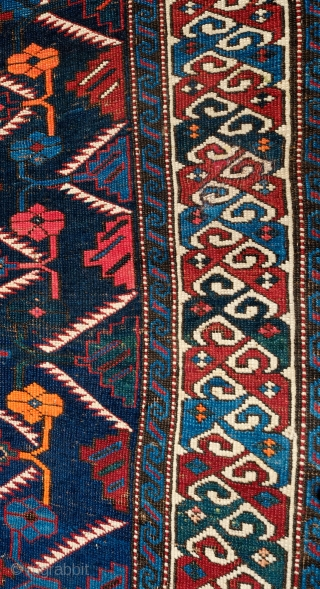 Shirvan or Kuba Rug, Late 19th Century. Blue ground with two shades of blue in a lattice and very minimized Afshan design.  The border is in a compound split leaf border.  ...