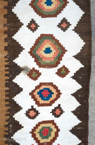 South Azerbaijan Kilim, Late 19th Century. Camel wool field surrounded by white border with striking colorful medallions. Excellent colors. It has a couple of stains, one on the upper medallion and another  ...