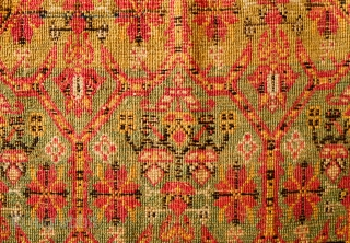 Feraghan Saddle Rug, 3rd to 4th quarters of 19th century.  The field is filled with cartouches that form a mihrab-like arch in the center and botehs surround the main border.   ...