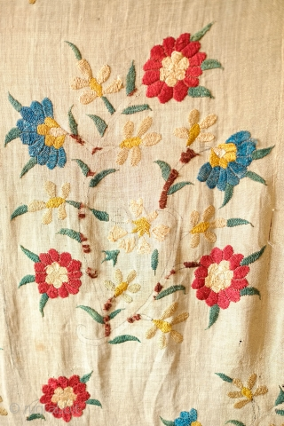 Algerian Suzani, 18th Century.  Overall floral motif in strong, vibrant colors in silk on linen.  The maroon-brownish silk has been coroded in the stems and border outlines.  This is  ...