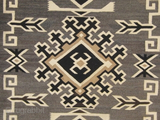 "Antique Navajo ""Two Grey Hills"", circa 1925-1930, 48"" by 70"", all undyed wool, very fine weave (40 to 50 wefts to the inch), in good condition (one small repair to the edge  ..."
