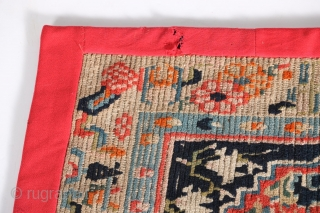 "Antique Tibetan mat or seat cover, first quarter of the 20th century, 23"" by 30"", with original edging and backing."