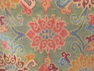 "Antique Tibetan sitting rug, circa 1880-1900.  Rare green ground, original red edging and blue cotton backing.  In very good condition with one small repair.  34"" by 23"".  Natural  ..."