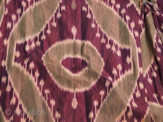 Uzbek allsilk ikat chapan.Late 19th century. Sleeves 62in lenght 50 inches (158 x 127 cm) Four colors.Lined with cotton Russian block print.Excellent condition. No stains, tears or holes.