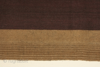 Bolivian mantle (nanaka) with bands of undyed vicuna colored alpaca wool on a ground of purple dyed sheep's wool, 40 x 41 inches (102 x 104cm), circa 1900-1950. The use of alpaca  ...