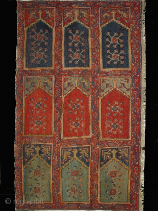 Ushak region carpet fragment of a large mosque prayer carpet with three rows of three prayer niches, late 18th century, 400cm high and 245cm wide. Condition: good overall even pile. Compared to most  ...