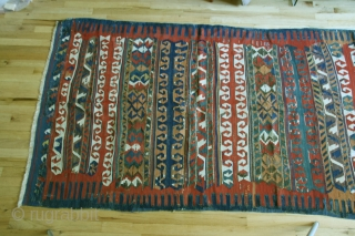 Anatolian kilim, circa 1800, 52 x 114 inches. A rare type of Yuncu multibanded kilim.Cleaned, with minor restorations throughout kilim