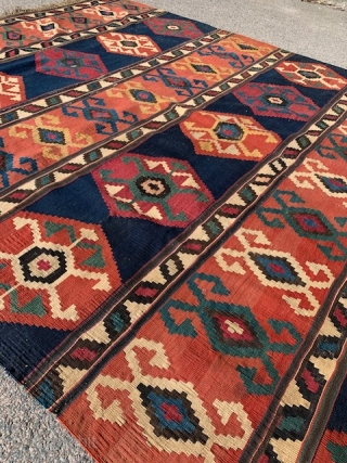 An antique southeast Cauacasian kilim with rams horn motif in rows with small bands in between.  It was made around the turn of the 19th century or shortly before. The color  ...