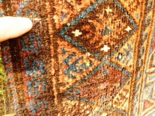 Timuri Prayer rug. Evidence of fuchsine. Moth damage and worn kink. Kelim ends nearly intact. Rear of carpet shown photos 6 & 8.