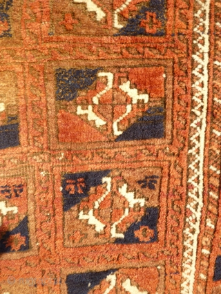 Baluch Rug with Turkmen motifs. Size 6 feet 4 inches x 3 feet 4 inches. Soft, even pile, corrosion to browns, losses to ends, slevedges worn- see photos. Finely woven wool on  ...