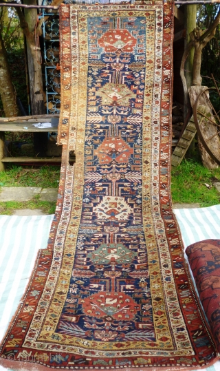 North West Persian Runner. Fragmented: missing outer border section, heat related damage in same area. Otherwise full pile with minimal damage. Good colours and interesting anthropomorphic motifs - see photos. Needs a  ...