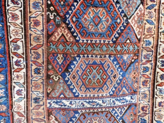 Kurdish rug. Wear to main ground with foundation showing in places. Sides need securing and tape has been added to reinforce them. Ends have been poorly secured. Great colours and a usable  ...