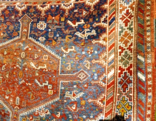 Colourful Khamseh 'chicken' carpet, 232 cm x 158 cm. Probably at least 100 years old with wonderful abrash in main field of different blues, nice greens in border. Two different yellows, one  ...