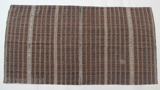 "18th-19th Century Indonesian Textile we call Tapis ""Inu"" Lampung, this saroong decorated with embroidery and ikat motive. Size: 112cm x 58cm. Good condition except minor loses on the embroidery and single spot  ..."