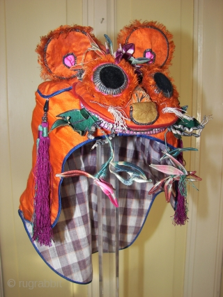 Best wishes to all rugrabbits ! ( Chinese silk cap, Foo dog ? .)
