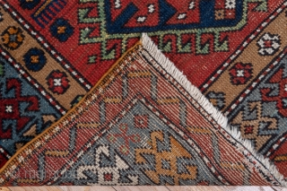 Karaje Runner  3.1 x 14.9 0.94 x 4.54   The abrashed warm madder red ground displays ten hooked, hexagonal medallions in ivory, pumpkin, dark  blue, medium blue,sandy camel and light blue, with  jewelry  ...