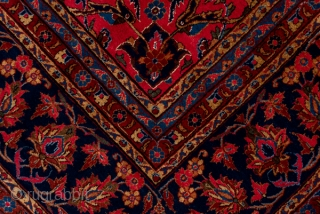 Kashan Carpet  8.8 x 12.0 2.68 x 3.65   This very  good condition central Persian city carpet shows a very slightly abrashed ruby red field with a tonally en suite medallion defined by dark  ...