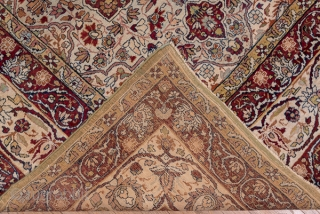 Kerman Carpet  9.0 x 12.0 2.74 x 3.65  On an old ivory field are set four eight-point red star medallions around which swirl flowering vines. The ivory main border of this SE Persian city carpet  ...