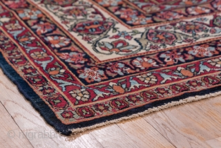 Kerman  Carpet  9.7 x 12.10 2.95 x 3.68   Traditionally termed  'Lavar', this SE Persian urban carpet has a huge, layered, all navy medallion exploding out of the ecru field and only constrained  ...