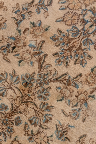 Kerman Narrow Runner  2.7 by 20.2 0.82 x 6.15  This good condition, well patinated SE Persian city runner shows a total old ivory ground with a flower spray and qua trefoil field pattern and open  ...