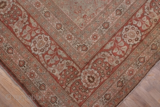 Tabriz Carpet  11.0 by 14.10 3.35 x 4.29  The beige field is closely covered by a small scale allover Herati pattern set within  a  border system including two ivory minors with pentagonal   ...