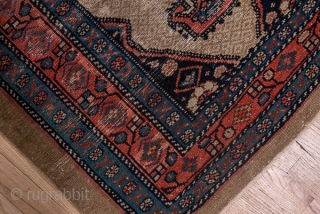 Hamadan Runner  2.10 x 14.3 0.64 x 4.35   This antique camel tone plain border runner  displays five black medallions with double hook pendants floating on a close lattice in camel and beige. The  ...