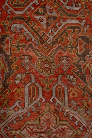 """Oushak Carpet  12.6 x 13.9 3.84 x 4.23  This almost square west Anatolian antique carpet is done in the 18 th century """"Smyrna"""" style with a Turkey bred field covered by a Yaprak (Leaf) pattern.  ..."""