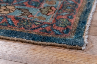Malayer Runner  3.2 x 13.7 0.97 x 4.17  This somewhat worn west Persian village runner displays an allover  pattern of two-way flowers, fan palmettes, little botehs and floating rosettes on a medium-dark blue field.  ...