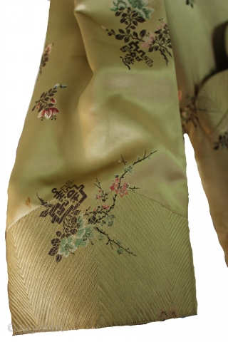 Absolutely breathtaking 19th century, silk couture Japanese kimono robe! Features the finest of gold silk, with a beautiful colorful flowers embroidered throughout. Hand sewn intricate stitching details on the bodice, sleeve cuffs,  ...