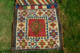 "NW Persian flat woven khorjin. 57"" X 25"". Early 20th C.  Wool. Dovetailed tapestry. Bright stable cheerful colors. Plain woven back in natural undyed black wool. Lovingly kept in almost perfect  ..."