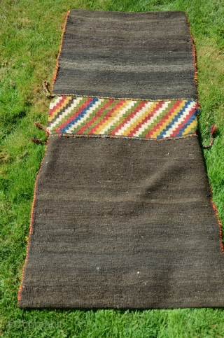 """NW Persian flat woven khorjin. 57"""" X 25"""". Early 20th C.  Wool. Dovetailed tapestry. Bright stable cheerful colors. Plain woven back in natural undyed black wool. Lovingly kept in almost perfect  ..."""