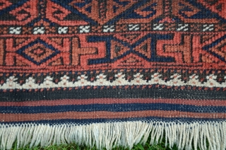 """Antique Baluch pile rug. 5'1"""" X2'10"""". Wool. Beautiful natural dyes. Excellent condition with original finishes including kilim ends and intact selvedges. Price includes shipping in USA."""