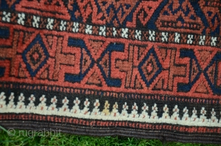 "Antique Baluch pile rug. 5'1"" X2'10"". Wool. Beautiful natural dyes. Excellent condition with original finishes including kilim ends and intact selvedges. Price includes shipping in USA."