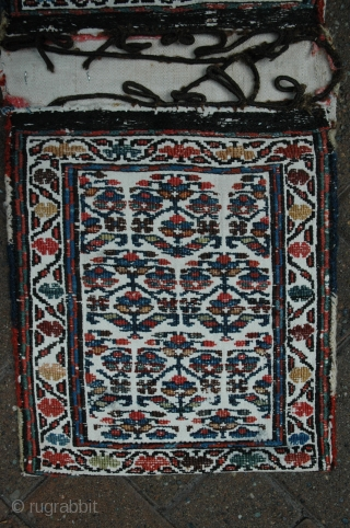 Shahsavan chanteh-khorjin, 19th C, 11-1/2 in. x 28-1/2 in. , natural dyes, bud and flower design, wool brocade on plain twill woven white ground; plain white back.  Cloth strip inside and  ...