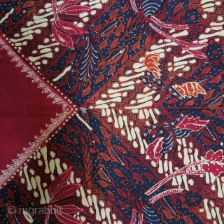 Java   Mid 20th C Hand-Drawn Batik Head Cloth (Iket Kepala)  Indonesia Java, Banyumas, mid 20th century  Commercial cotton and dyes, hand-drawn batik (tulis)  A dramatic ceremonial square that contrasts the cherry red square diamond  ...
