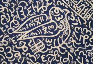 Sumatra   Calligraphic batik with birds (batik tulisan Arab burong)  Coffin cover or hanging  Sumatra, Bengkulu, c. 1940  Commercial cotton and dye, hand-drawn batik (tulis)   A graphic dark blue Batik Tulisan Arab hand-drawn with the  ...