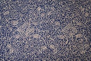 Sumatran Calligraphic Batik with Birds (Batik Tulisan Arab Burong)  Type: Coffin cover or hanging  Origin: Sumatra, Bengkulu, c. 1940  Technique: Commercial cotton and dye, hand-drawn batik (tulis)   Description: A graphic dark blue Batik Tulisan Arab  ...