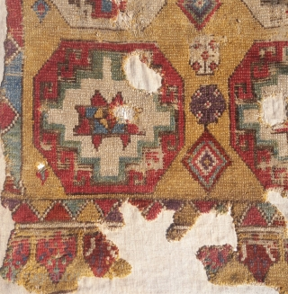 Konya area rug fragment,Mounted on linen. Probably late 18th early 19th century, possibly older. Subtle colouring, bold design. 76in by 42in